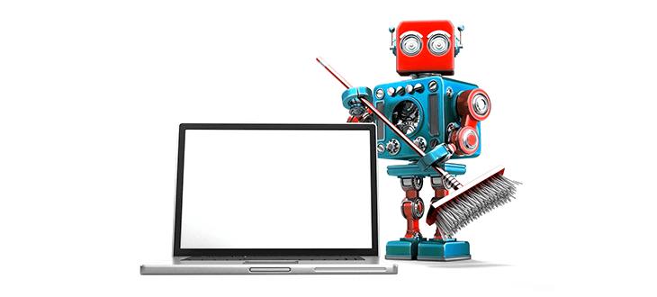 Putzroboter neben Laptop